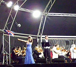 Elizabeth MacDonald and John Hudson leading the crowd in proms singing